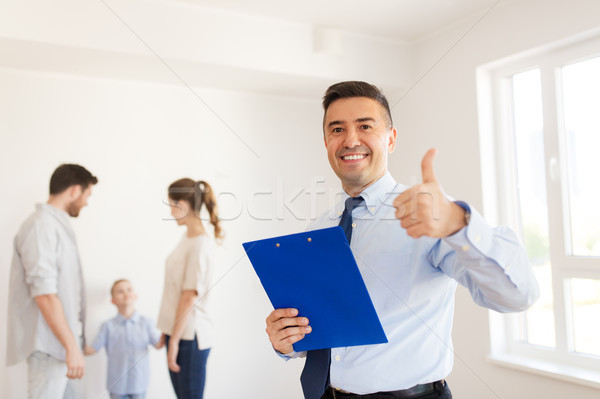 realtor with clipboard showing thumbs up Stock photo © dolgachov
