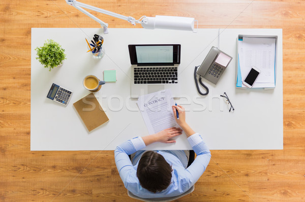 businesswoman signing contract document at office Stock photo © dolgachov
