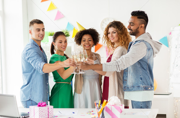 happy team with champagne at office birthday party Stock photo © dolgachov