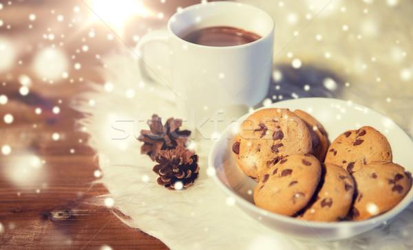Csészék forró csokoládé sütik szőr szőnyeg ünnepek Stock fotó © dolgachov