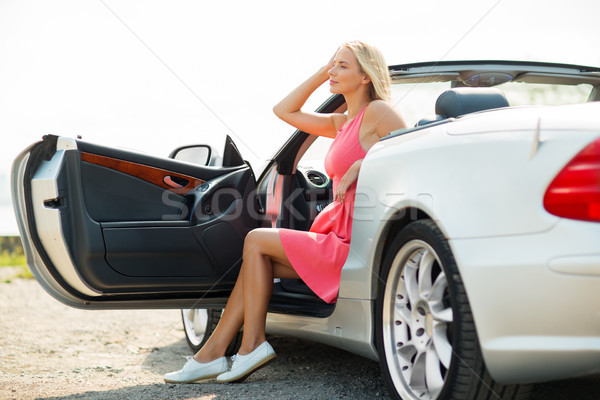 happy young woman porisng in convertible car Stock photo © dolgachov