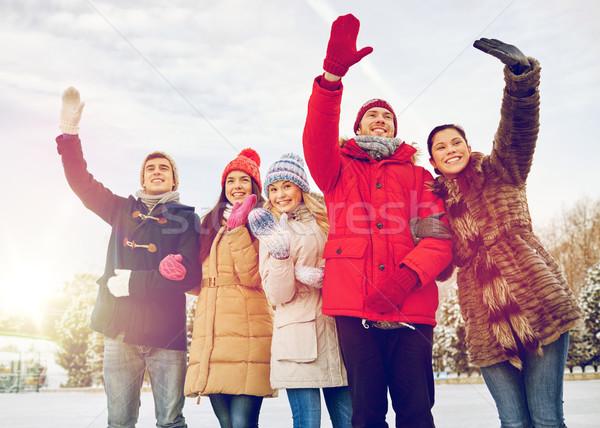 happy friends waving hands outdoors Stock photo © dolgachov