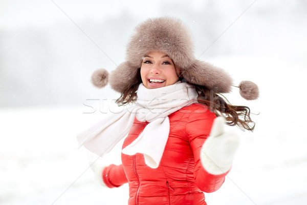 happy woman in winter fur hat outdoors Stock photo © dolgachov
