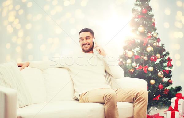 man calling on smartphone for christmas Stock photo © dolgachov