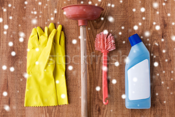 plunger with toilet cleaning stuff on wood Stock photo © dolgachov