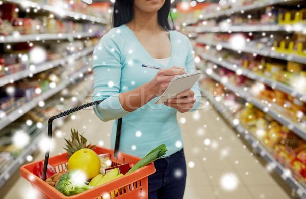 customer with shopping basket at supermarket Stock photo © dolgachov