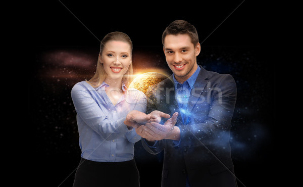 businessman and businesswoman over space Stock photo © dolgachov