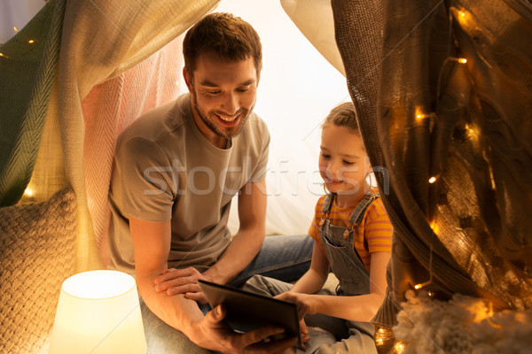 family with tablet pc in kids tent at home Stock photo © dolgachov