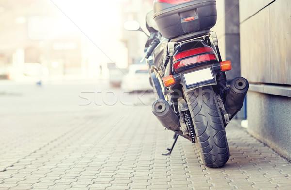 close up of motorcycle parked on city street Stock photo © dolgachov