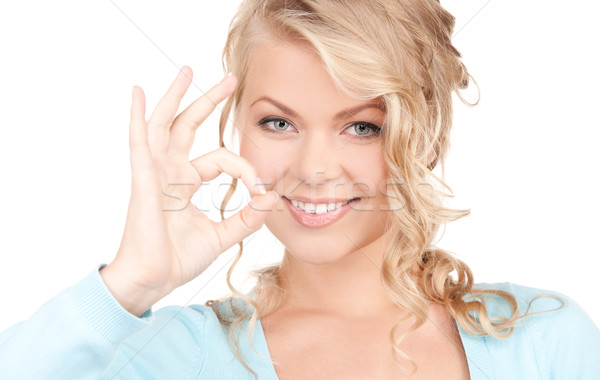 bright picture of lovely blonde showing ok sign Stock photo © dolgachov