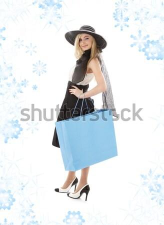Signora arancione shopping bag fiocchi di neve elegante felice Foto d'archivio © dolgachov