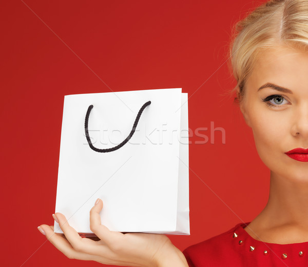 lovely woman in red dress with shopping bag Stock photo © dolgachov