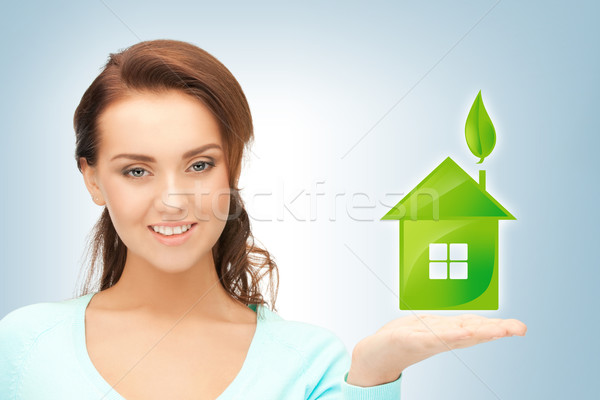 woman holding green house in her hands Stock photo © dolgachov