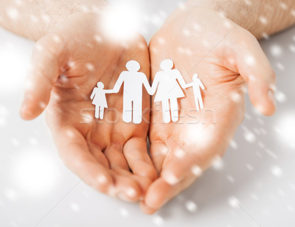man hands showing family of paper people Stock photo © dolgachov