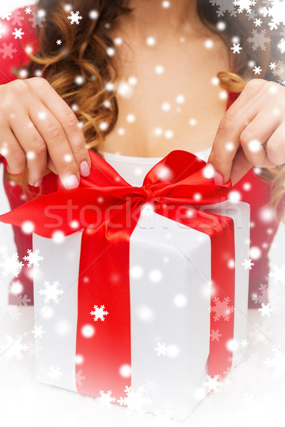 woman hands opening gift boxes Stock photo © dolgachov