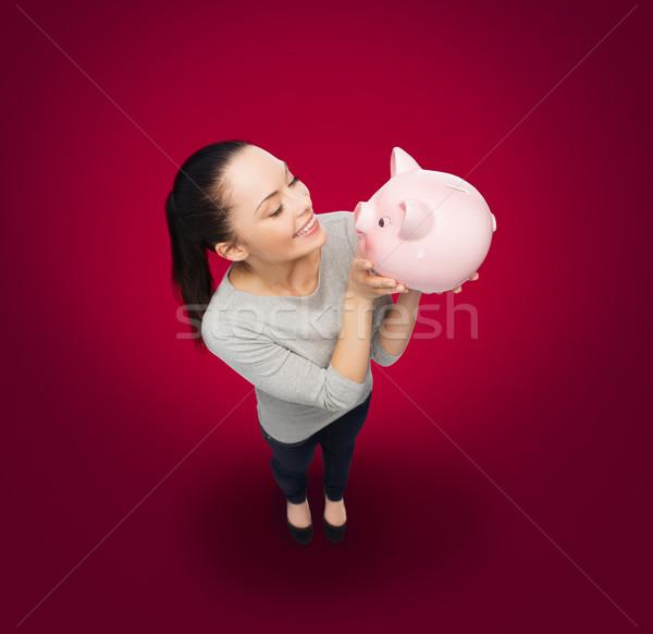 Photo stock: Heureux · femme · regarder · tirelire · bancaires · investissement