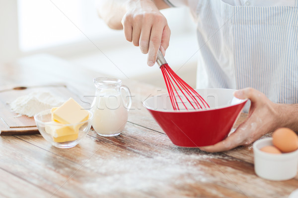 close up of male hand whisking something in a bowl Stock photo © dolgachov
