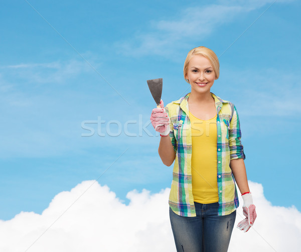 smiling female worker in gloves with spatula Stock photo © dolgachov