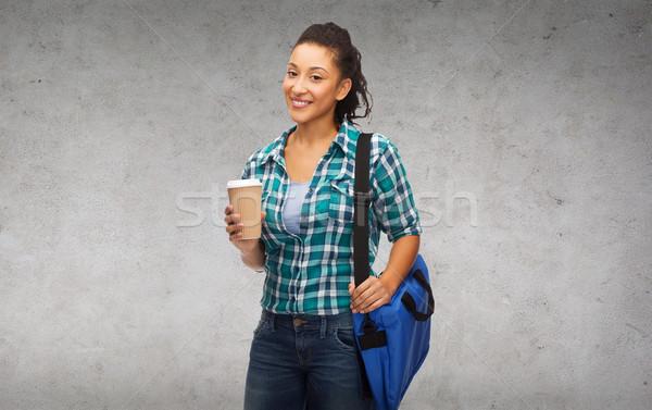 Uśmiechnięty student worek z dala filiżankę kawy Zdjęcia stock © dolgachov