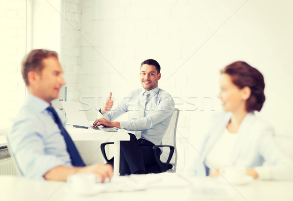 happy businessman showing thumbs up in office Stock photo © dolgachov
