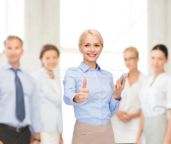 Fiatal mosolyog üzletasszony okostelefon üzlet technológia Stock fotó © dolgachov