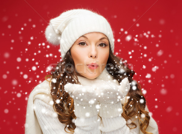 happy woman in winter clothes blowing on palms Stock photo © dolgachov