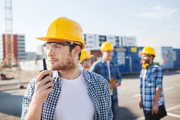 Csoport építők rádió üzlet épület csapatmunka Stock fotó © dolgachov