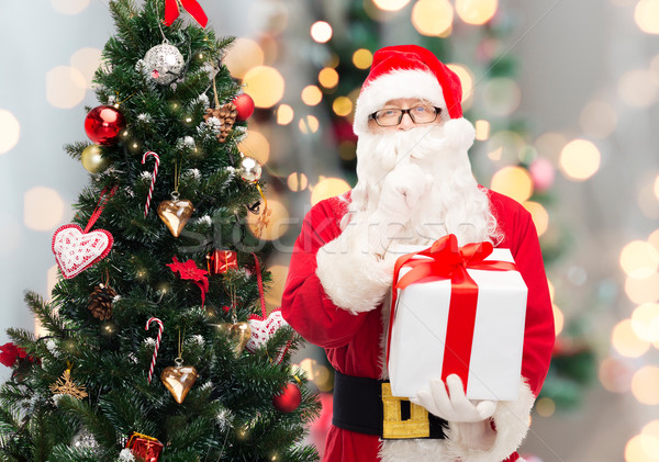 man in costume of santa claus with gift box Stock photo © dolgachov