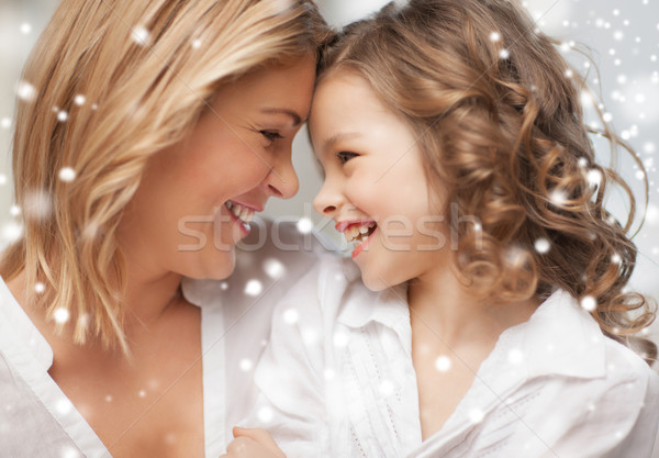 happy mother and daughter cuddling Stock photo © dolgachov