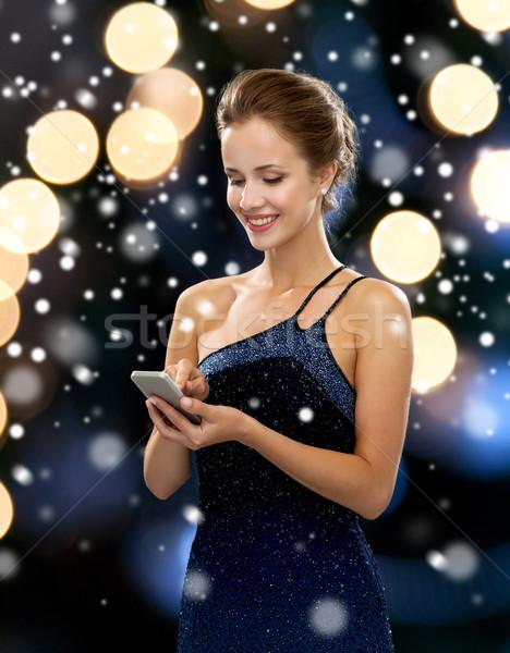 Sorrindo vestido de noite tecnologia comunicação férias Foto stock © dolgachov