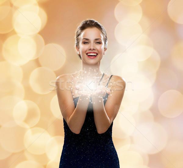 Nevet nő estélyi ruha tart valami ünnepek Stock fotó © dolgachov