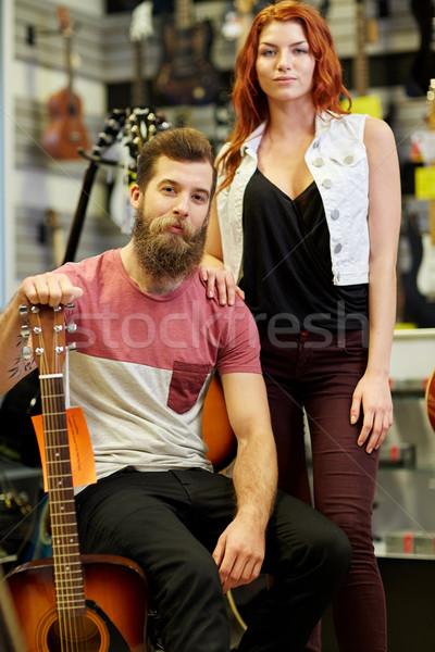 Pár zenészek gitár zene bolt vásár Stock fotó © dolgachov