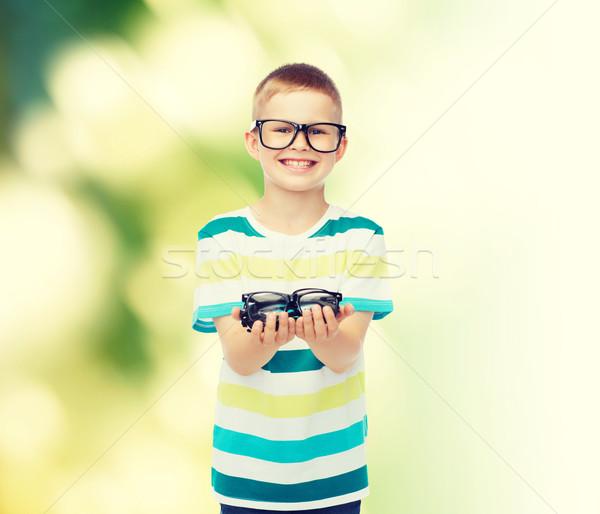 Sorridere ragazzo occhiali visione Foto d'archivio © dolgachov