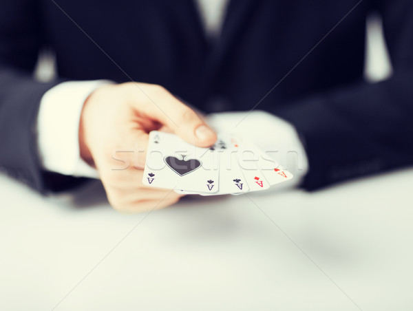 man hand showing four aces Stock photo © dolgachov