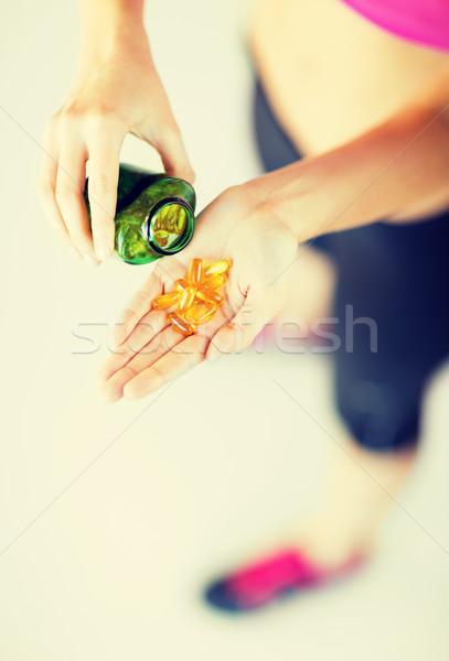 woman hand with capsules Stock photo © dolgachov