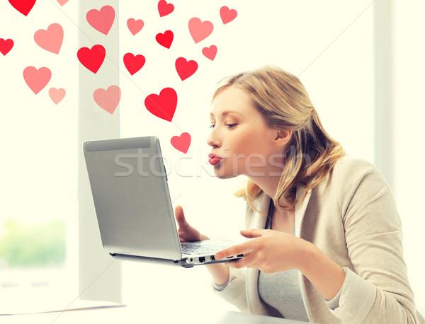 Nő küldés laptop számítógép virtuális kapcsolatok online Stock fotó © dolgachov