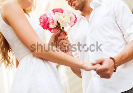 close up of happy lesbian couple with flowers Stock photo © dolgachov