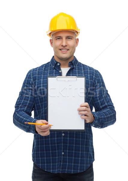Glimlachend mannelijke bouwer helm reparatie Stockfoto © dolgachov