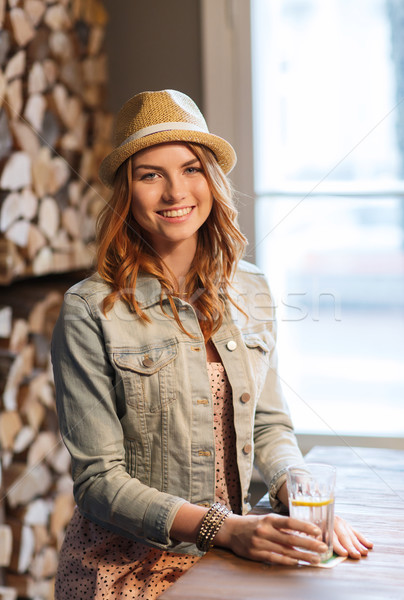 happy young woman drinking water at bar or pub Stock photo © dolgachov