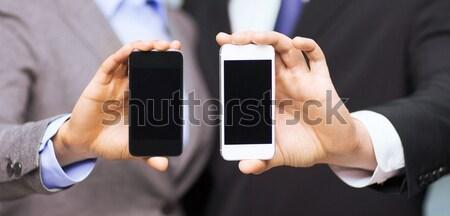Stok fotoğraf: Işadamı · işkadını · akıllı · telefonlar · iş · teknoloji · Internet