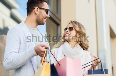 happy couple with shopping bags in city Stock photo © dolgachov