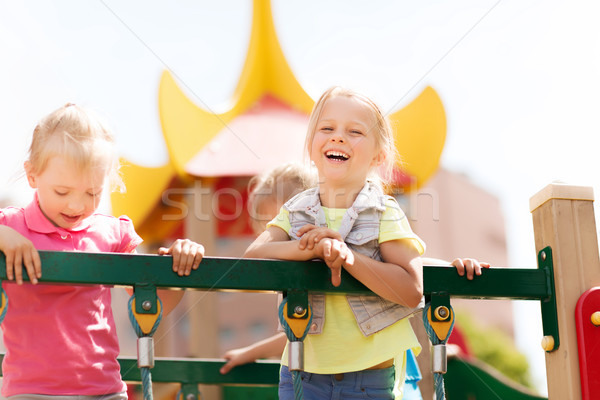 happy little girls on children playground Stock photo © dolgachov