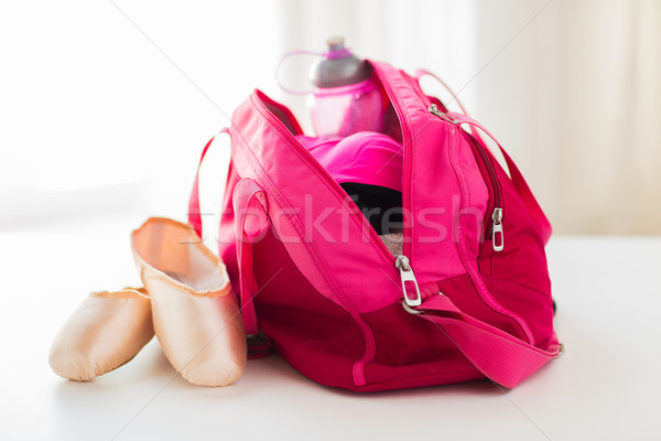 close up of pointe shoes and sports bag Stock photo © dolgachov