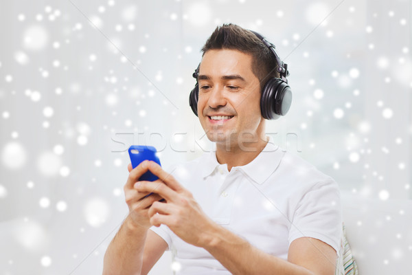 счастливым человека смартфон наушники технологий люди Сток-фото © dolgachov