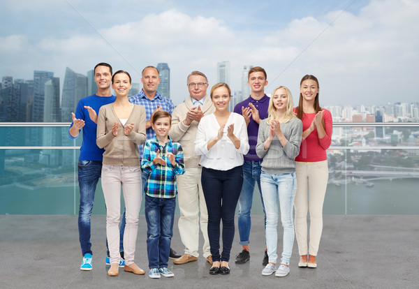 group of people applauding over city waterside Stock photo © dolgachov