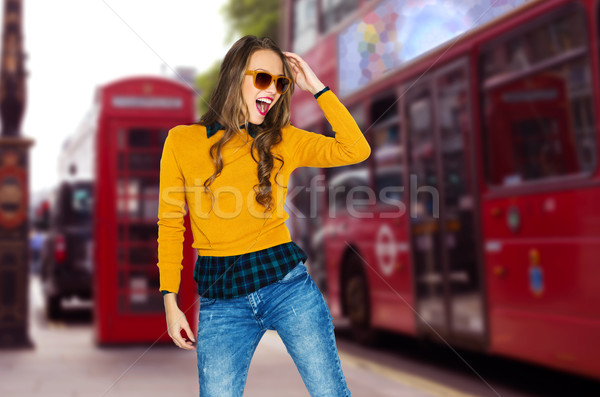 happy young woman or teen over london city street Stock photo © dolgachov