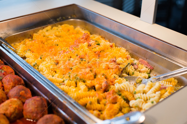 close up of pasta and meatballs on catering tray Stock photo © dolgachov