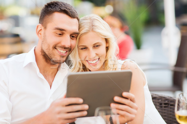 happy couple with tablet pc at restaurant lounge Stock photo © dolgachov