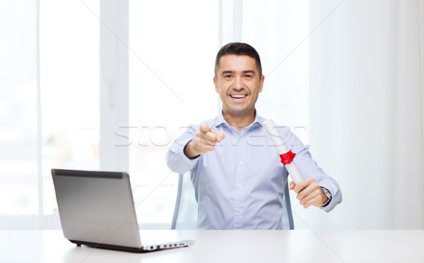 man with diploma and laptop pointing finger Stock photo © dolgachov