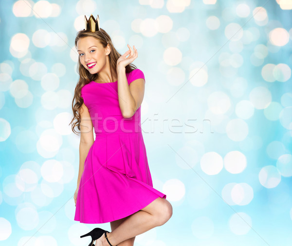 happy young woman or teen girl in princess crown Stock photo © dolgachov
